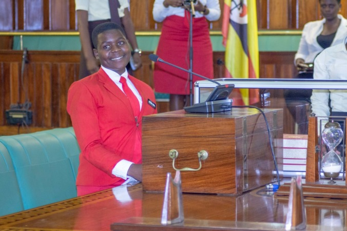 Head Prefect of Bishop Comboni tabling a motion in parliament
